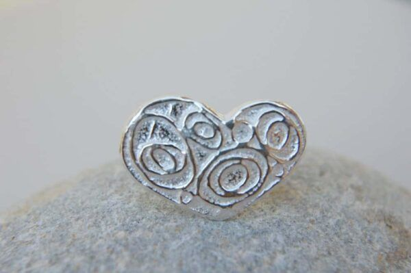 silver ring with heart form